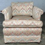 Tuxedo Style Skirted Lounge Chair with Rolled Arms and Flame Stitch Upholstery