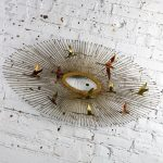 Mid Century Modern Oval Sunburst and Bird Wall Sculpture Attributed to C. Jere