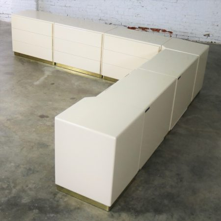 Five Milo Baughman Thayer Coggin Ivory Lacquered Cabinets and Two Corner Units with Brass Plated Bases