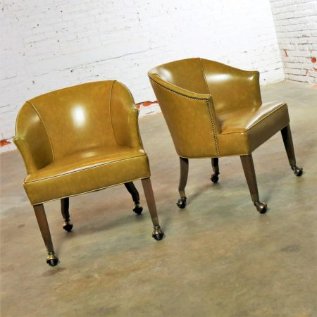 Pair of Mid Century Naugahyde Olive Green Rolling Barrel Chairs with Nail Head Accent