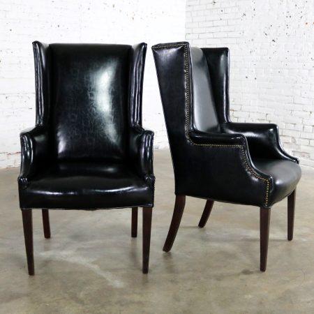 Black Naugahyde Art Deco Hollywood Regency Wingback Chairs with Nailhead Detail a Pair
