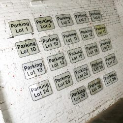 Twenty-Three Vintage Metal Parking Lot Number Signs