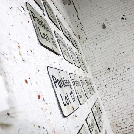 Twenty-Three Vintage Metal Parking Lot Number Signs