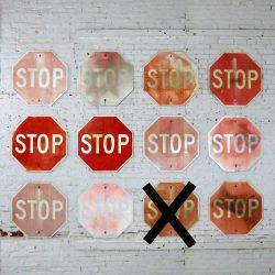 Twelve Vintage Metal Stop Signs