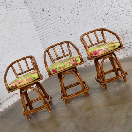 Three MCM Rattan Swivel Counter Height Bar Stools by Rattan Specialties, Inc.